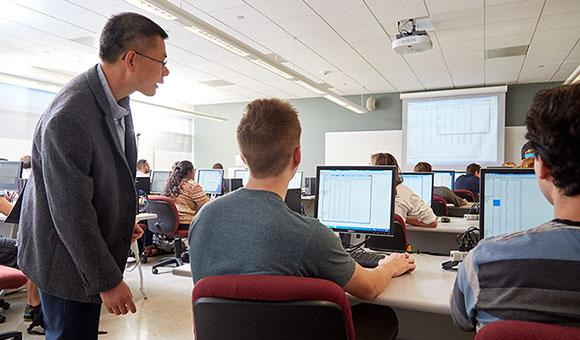 Jianbiao John Pan helping students