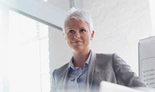 Blonde woman in gray business suit
