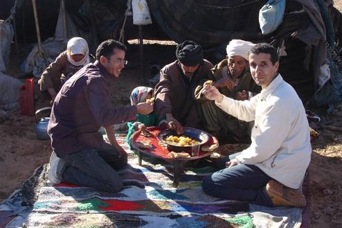 Bedouins eating in front of their tent