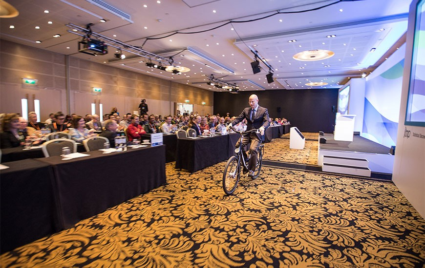Jeff cycles pass attendees at the Discovery Summit Europe Amsterdam