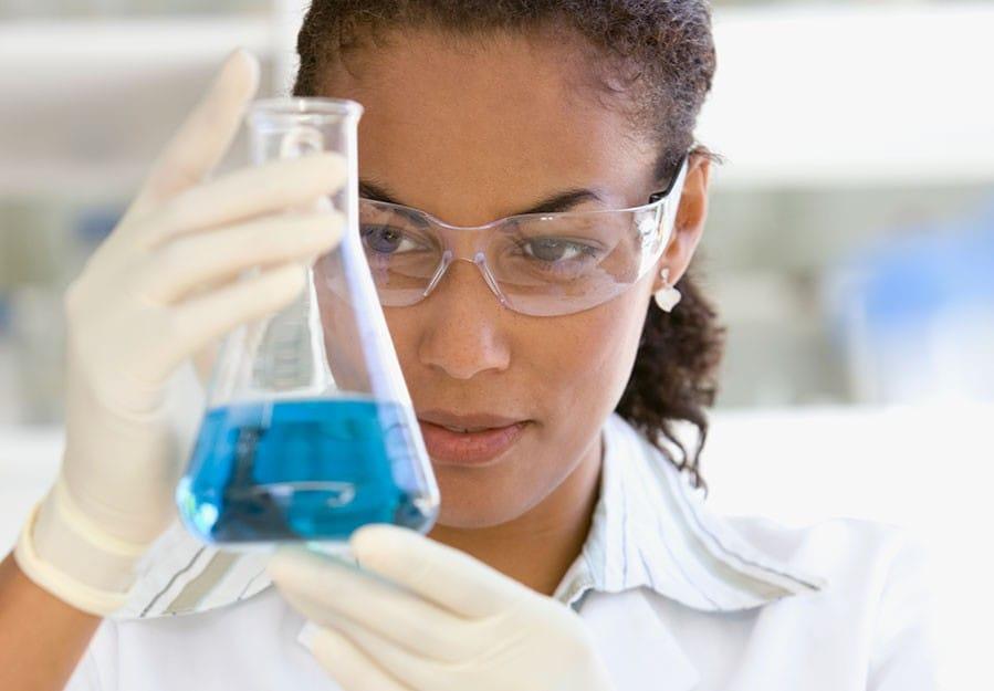 woman holding beaker
