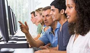 Instructor in computer lab with students