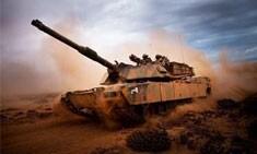US Marine tank driving down dirt road